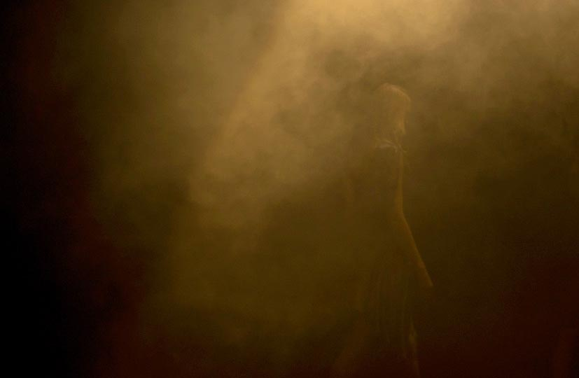 photo by photographer danny roberts of a girl walking through a a mysterious foggy scene in A degree Fahrenheit runway show in tokyo fashion week spring 2012