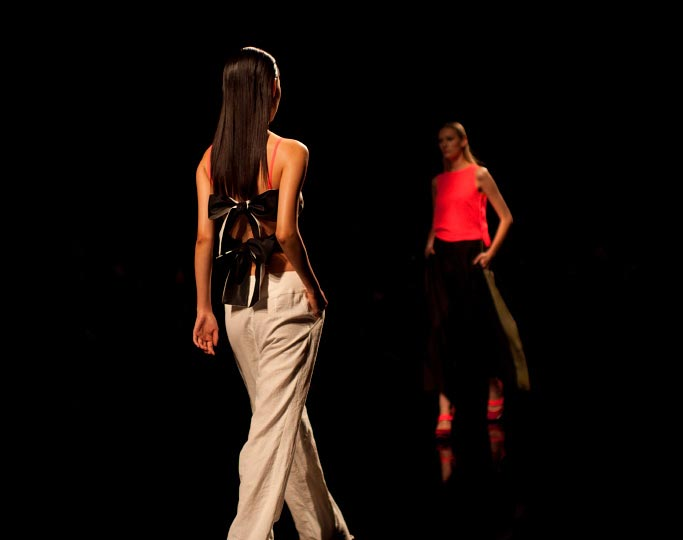 Danny Roberts horizontal picture of two girls walking down the runway girls back with bows on her nude back in Araisara Tokyo Fashion week Spring 2012 Collections