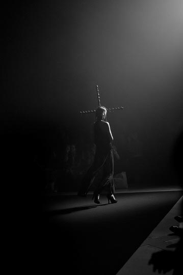 Photographer danny roberts black and white photo of a girl hold a cross in Tokyo Fashion week Designer Christian Dada Spring 2012 collection