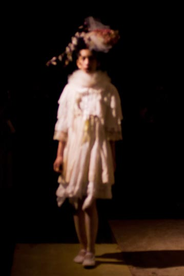 Artist Danny Roberts ghostly out of focus picture of a mori girl wearing flowers in her hair and white dress in furfur spring 2012 collection tokyo fashion week