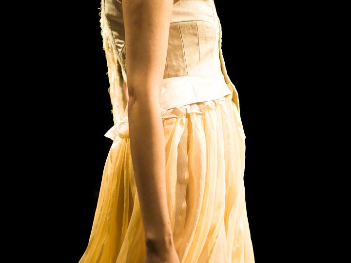 Close up photo of a beautiful pale yellow dress by Junya Tashiro spring 2012 collection at tokyo fashion week photograph by Danny Roberts