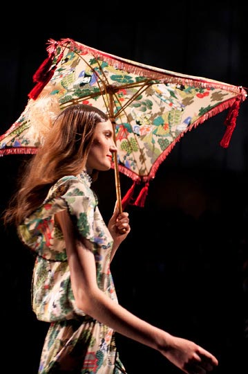 Danny Roberts Picture of a women Model holding a red umbrella and an ornate japanese dress in Keita Maruyama Spring fashion show for tokyo fashion week 2012