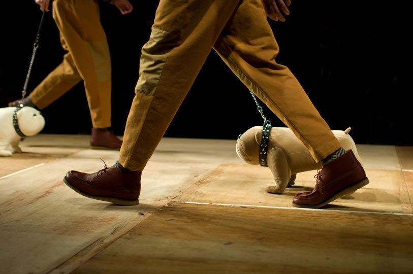 Photo from Photographer Danny Roberts of two peoples feet walking stuffed dogs during Ne-nets show during Tokyo Fashion Week spring 2012