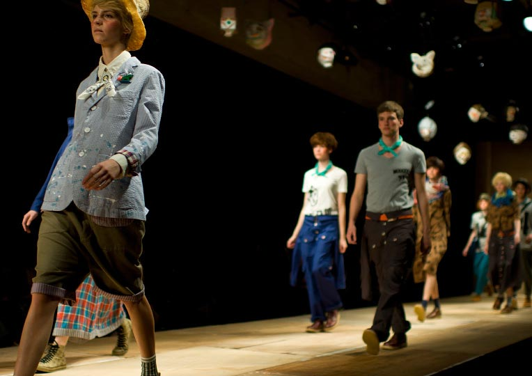 A horizontal picture of hand full of guys and girls walking down the runday during Ne-nets show at Tokyo Fashion Week spring 2012 Photo by Artist Danny Roberts