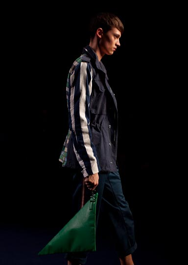 Photo from Photographer Danny Roberts of a standing Profile of Male model in a blue jacket walking in Phenomenon Fashion show at Tokyo Fashion Week Spring 2012