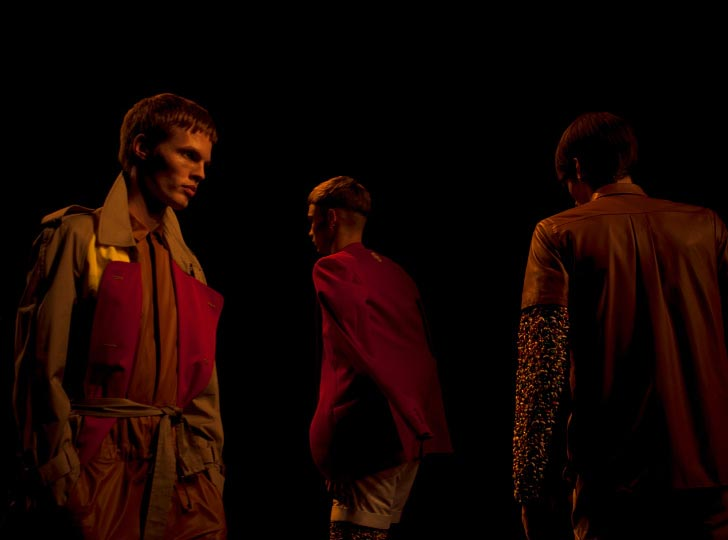 Horizontal Photo of 3 Male Models in bright clothes walking down the runway in Phenomenon spring 2012 collection for Tokyo Japan Fashion week by danny roberts