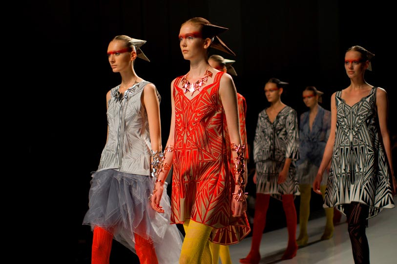 A horizontal picture of models with cone like hair runday during Somarta show at Tokyo Fashion Week spring 2012 Photo by Artist Danny Roberts