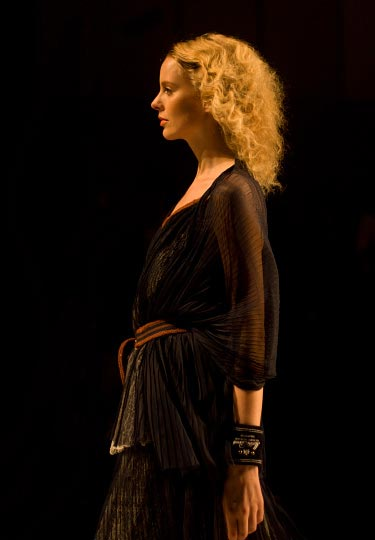 A warm colored photo by danny roberts of a curly haird blond girl in a slightly see through black dress from The Dress Co by designer Kideaki Sakaguchi in the tokyo fashion week spring 2012