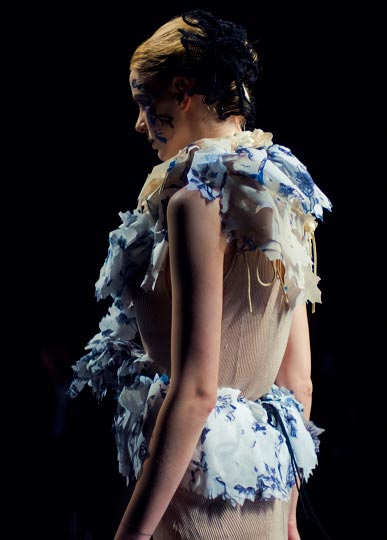 Artist Danny Roberts profile Picture of a female model in a pretty white and blue frill dress in Yasutoshi Exumi spring 2012 collection at tokyo fashion week